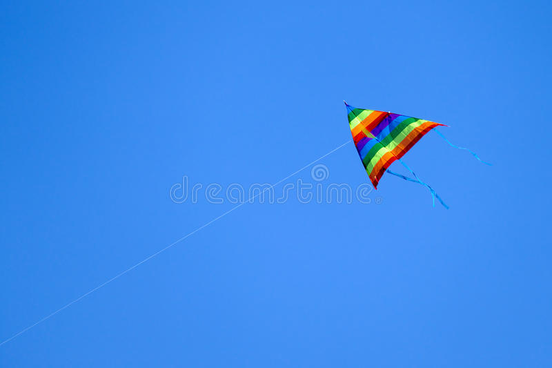 Colorful kite flying on background sky. stock image