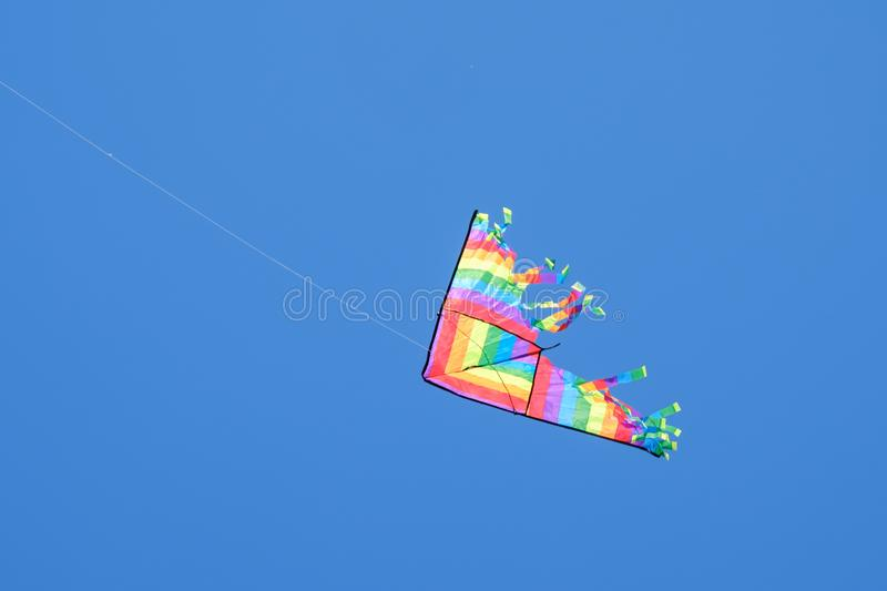 Colorful kite flying in the wind. Colorful kite flying in the wind blue sky royalty free stock photo