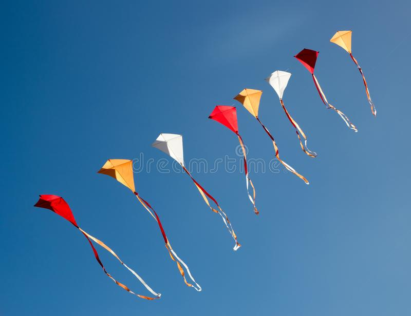 Colorful kites in a row royalty free stock image