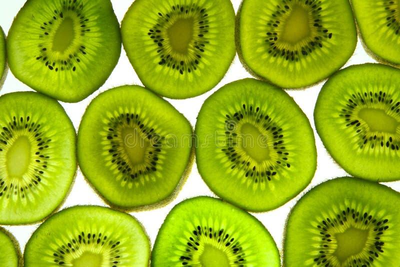 Colorful kiwi fruit. Colorful green kiwi fruit slices on a white background stock photos