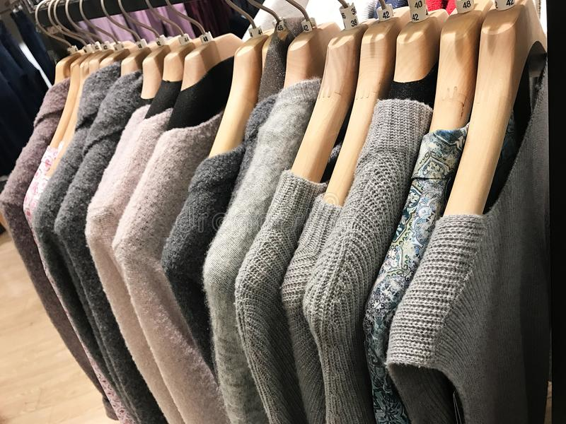 Colorful knit sweater cashmere on a clothes rack stock images