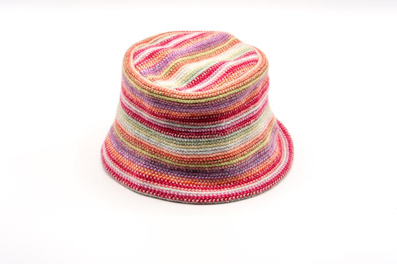 Colorful knitted hat on a white background. Handwork. Fashion concept for men, women and children stock photos