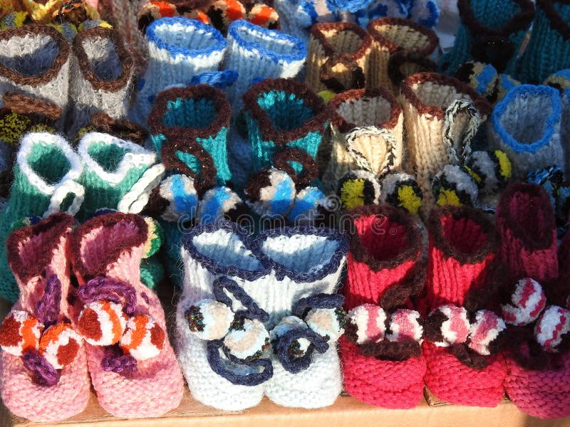 Colorful small babies slippers for sale, Lithuania royalty free stock photography