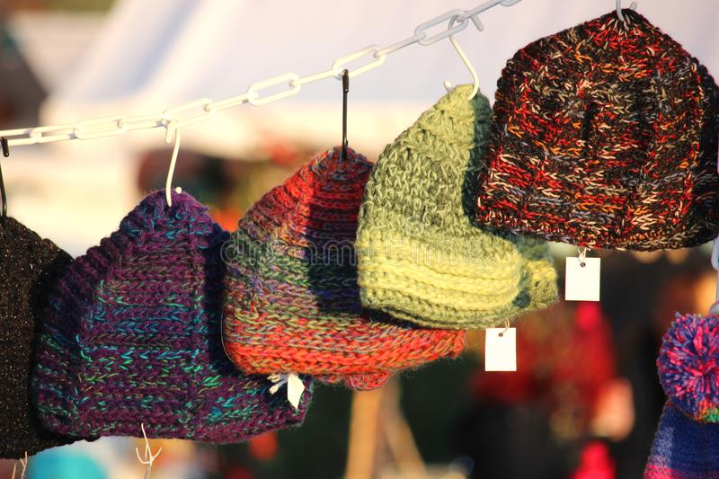 Colorful knitted warm wool handmade winter caps stock photos