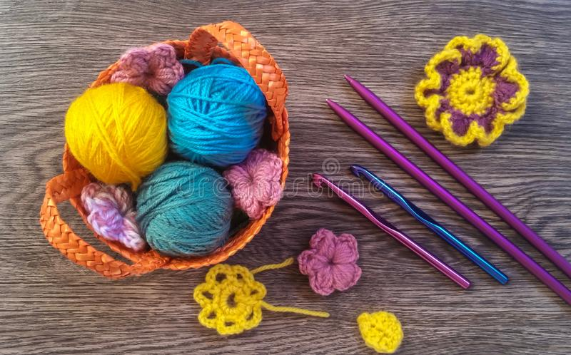 Colorful knitting in wicker basket royalty free stock photography