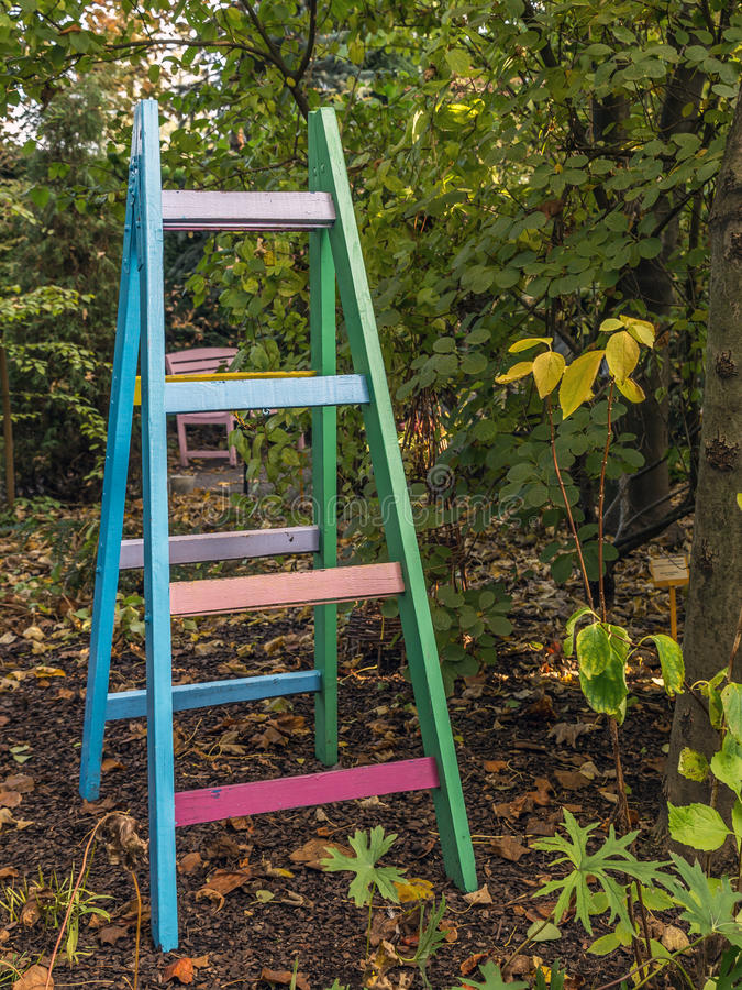 Colorful ladder in the garden royalty free stock image