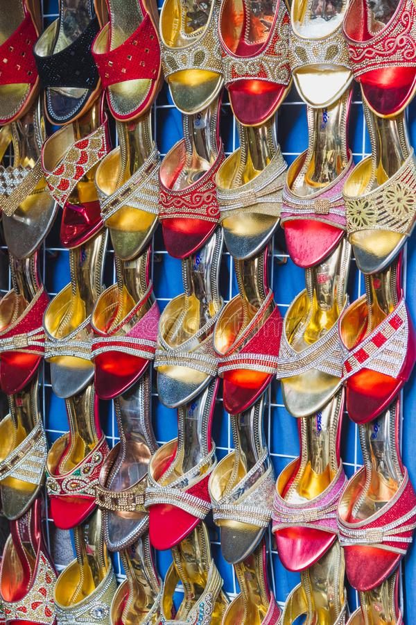 Colorful Ladies Footwear sandles for sale in the Market,Footwear Background stock photo