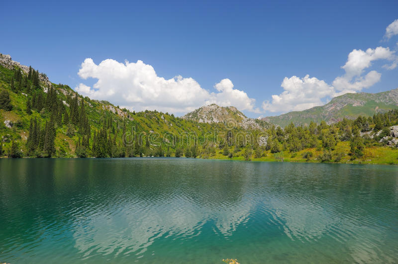 Colorful lake, mountains, sky and clouds stock photography