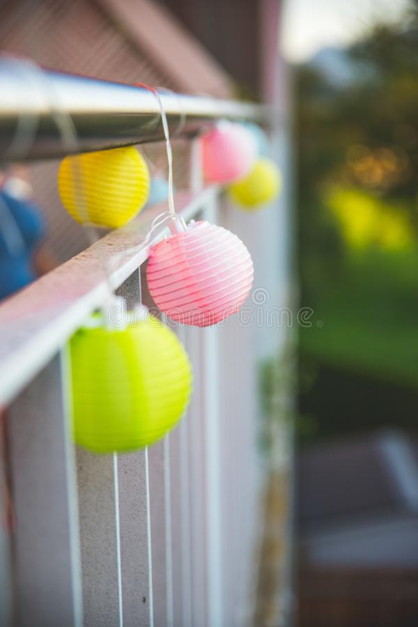 Lampions in the evening: Garden party in summer. Colorful lampions outside, evening, garden party light outdoors decoration summer carnival cosy weekend relax royalty free stock images