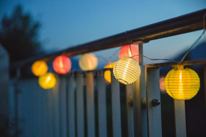 Lampions in the night: Garden party in summer. Colorful lampions outside, twilight hour, garden party night outdoors decoration summer carnival cosy weekend royalty free stock photography