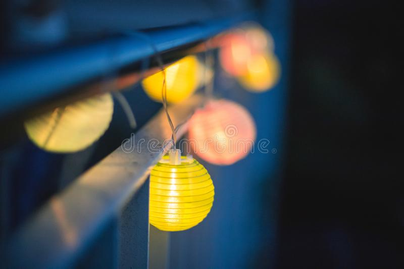 Lampions in the night: Garden party in summer. Colorful lampions outside, twilight hour, garden party night outdoors decoration summer carnival cosy weekend royalty free stock photo