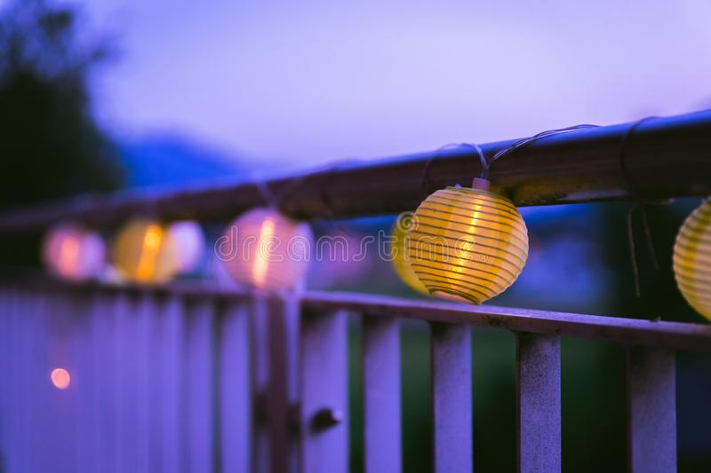 Lampions in the night: Garden party in summer. Colorful lampions outside, twilight hour, garden party, night, outdoors, decoration, summer, cozy, youth, weekend royalty free stock photography