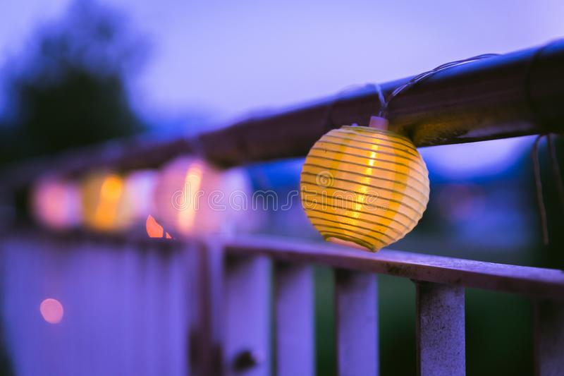 Lampions in the night: Garden party in summer. Colorful lampions outside, twilight hour, garden party, night, outdoors, decoration, summer, cozy, youth, weekend stock photos
