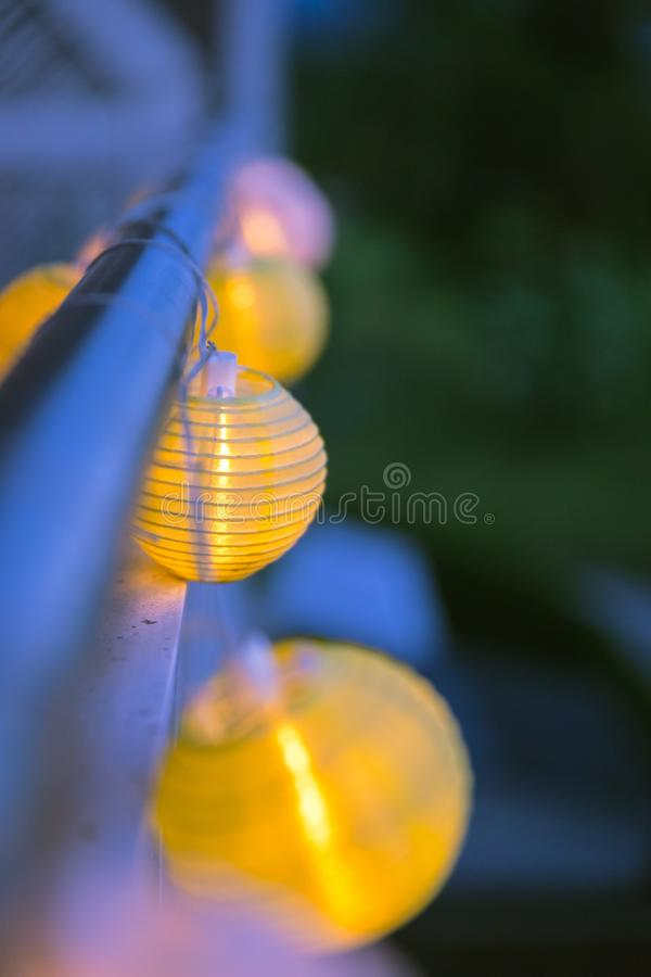 Lampions in the night: Garden party in summer. Colorful lampions outside, twilight hour, garden party, night, outdoors, decoration, summer, cozy, youth, weekend royalty free stock photo