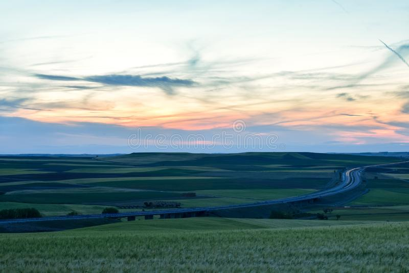 Colorful landscape of sunset in farmland royalty free stock image