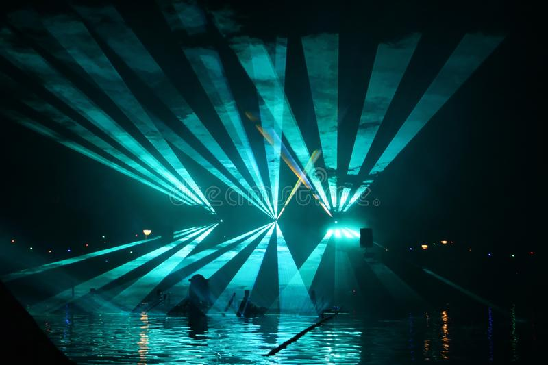 Colorful lasershow at the ring canal Zuidplaspolder during the Vlootschouw event in Nieuwerkerk aan den IJssel. Colorful lasershow at the ring canal royalty free stock photo