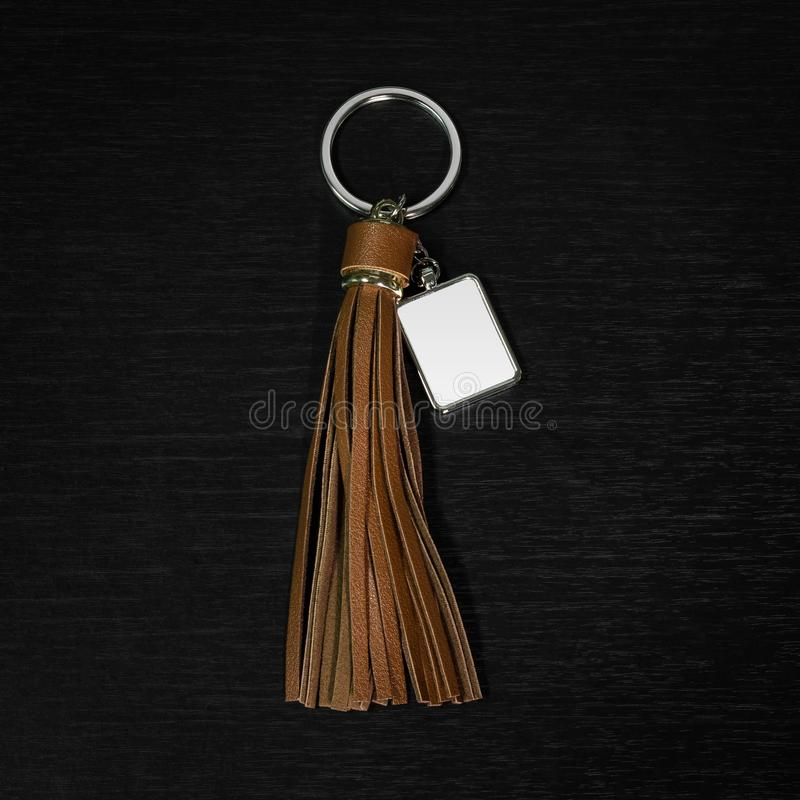 Colorful Leather Tassel key ring on black wooden background. Fashion leather key chain for decoration. Colorful Leather Tassel key ring on black wooden royalty free stock photography