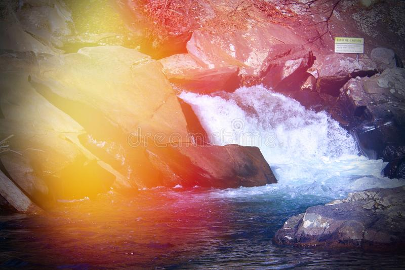 Colorful Lens Flares on a River in the Smokey Mountains Park. Colorful Lens Flares on a River Rapids in the Smokey Mountains Park royalty free stock photos