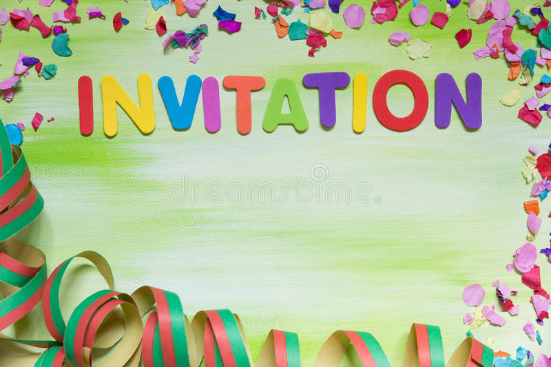 Colorful letters and confetti, word invitation royalty free stock photos