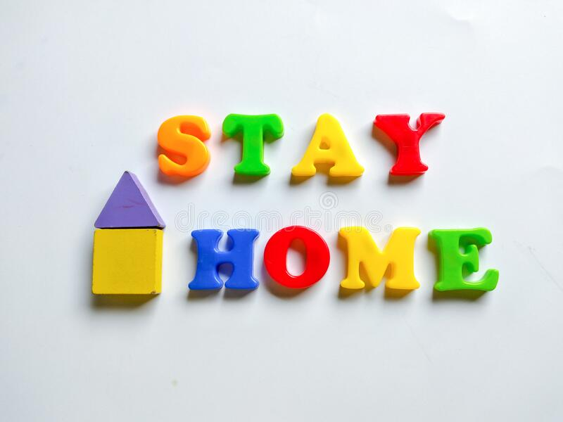 colorful letters form the expression stay at home royalty free stock photo