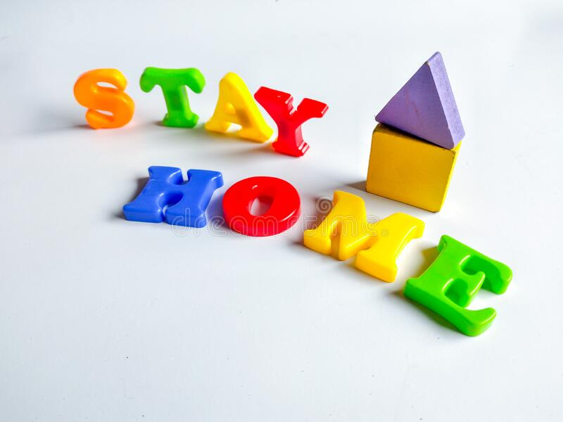 colorful letters form the expression stay at home isolated on white background stock photos