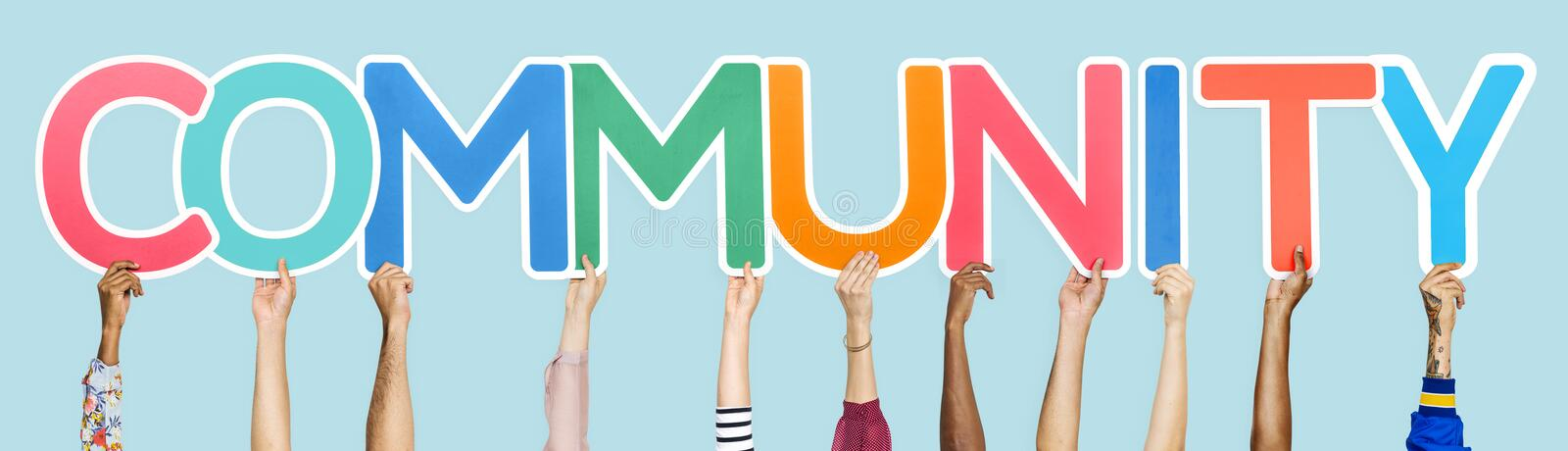 Colorful letters forming the word community stock photos