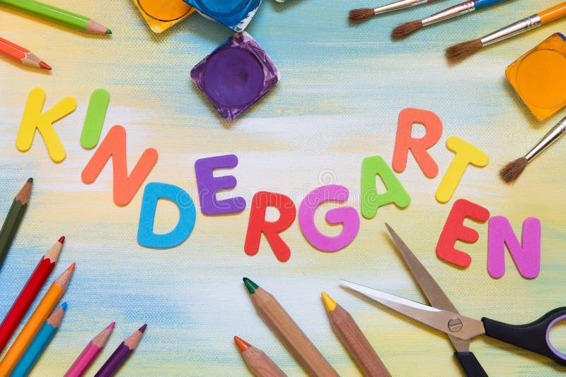 Colorful letters, school supplies, kindergarten stock photo