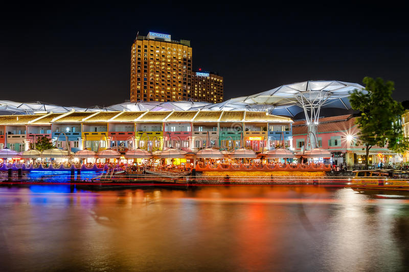 Colorful light building at night in Clarke Quay, located within the Singapore River Area. Singapore, Singapore - August 9,2012: Colorful light building at night stock image
