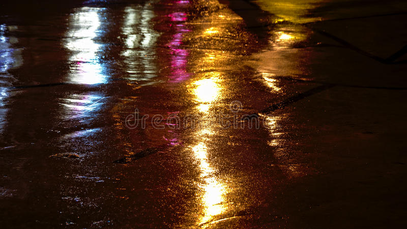 Colorful light reflections background. Background of colorful light reflections on wet concrete at night royalty free stock photos