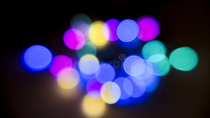 Multi-colored lights, defocused on black background real shooting stock photography
