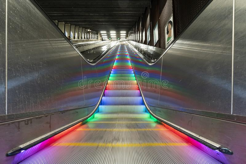 Colorful lights  in the metro scalators in Stockholm royalty free stock photography