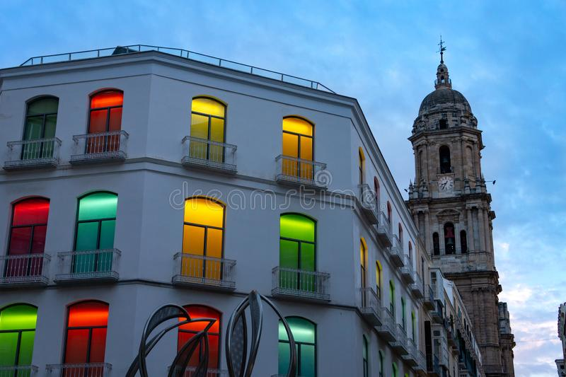 Colorful lights in windows of an building in Malaga Spain with Cathedral after sunset. Colorful lights in windows of an building in Malaga Spain with Cathedral royalty free stock photos