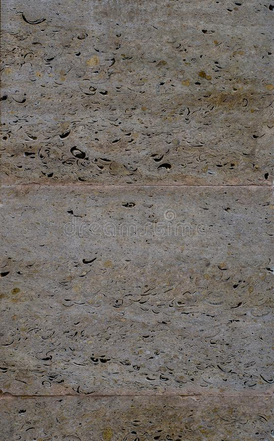 Colorful a limestone with many different colors like white, light brown, dark brown and many other. Massive natural stone with very good appearance stock image