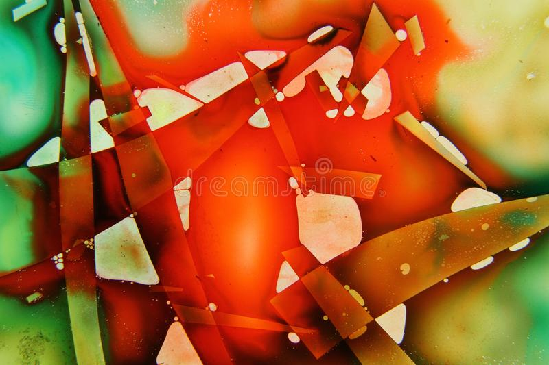 Colorful liquids mixed together to an abstract painting. Colored liquids mixed together in fluid creating colorful abstract painting consisting of gradients and stock photo