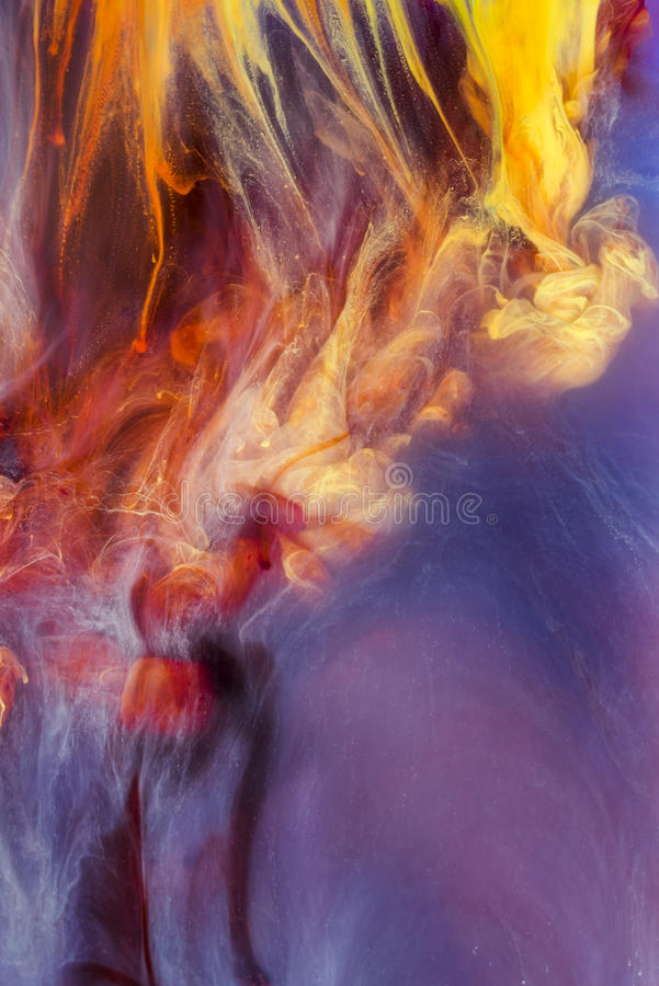 Colorful liquids underwater. Colorful abstract composition. Colorful abstract composition. Interesting shapes, patterns, rich textures, color mixing. Space for royalty free stock photography