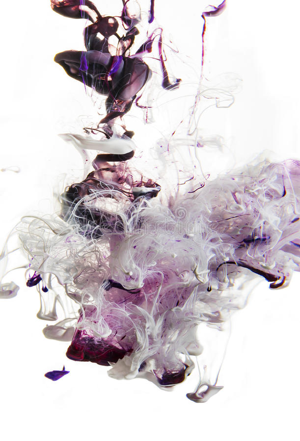 Colorful liquids underwater. Violet. magenta mix with white in pink color composition royalty free stock images