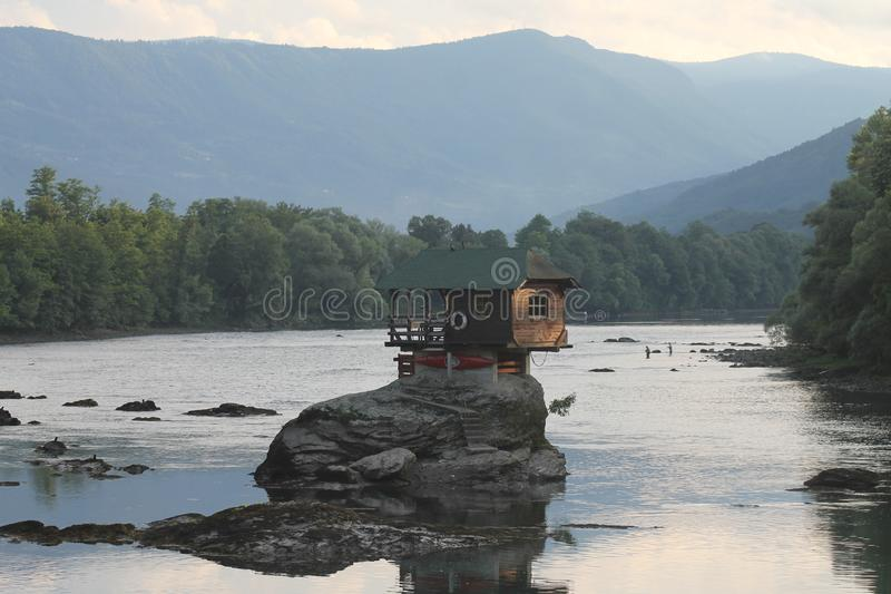 Lonely house on the river Drina in Bajina Basta, Serbia. Cabin, forest. Colorful little house on the rock on the middle of the Drina river in west Serbia, one royalty free stock photo
