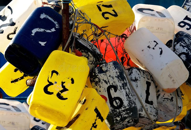 Colorful Lobster Buoys, colorful fishing buoys with numbers, buoys close up, many buoys in one place fragment view, colorful royalty free stock images