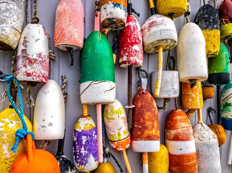 Lobster buoys on wall in Maine stock photo