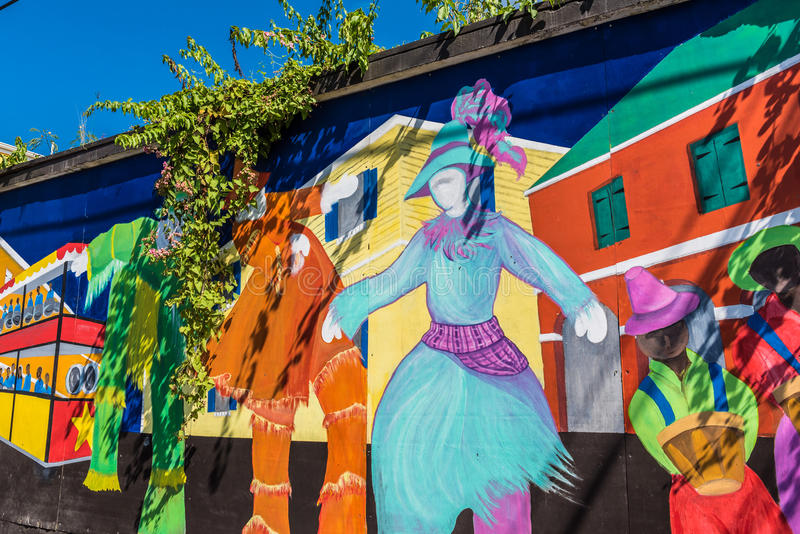 Colorful local Caribbean expressionism on a wall in downtown Fr. Ederikstedsted royalty free stock image