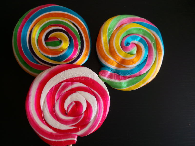 Colorful lollipop on dark background stock photo