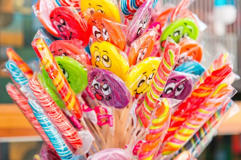 Colorful lollipops and candies with smiling faces outdoors for sale. stock photography
