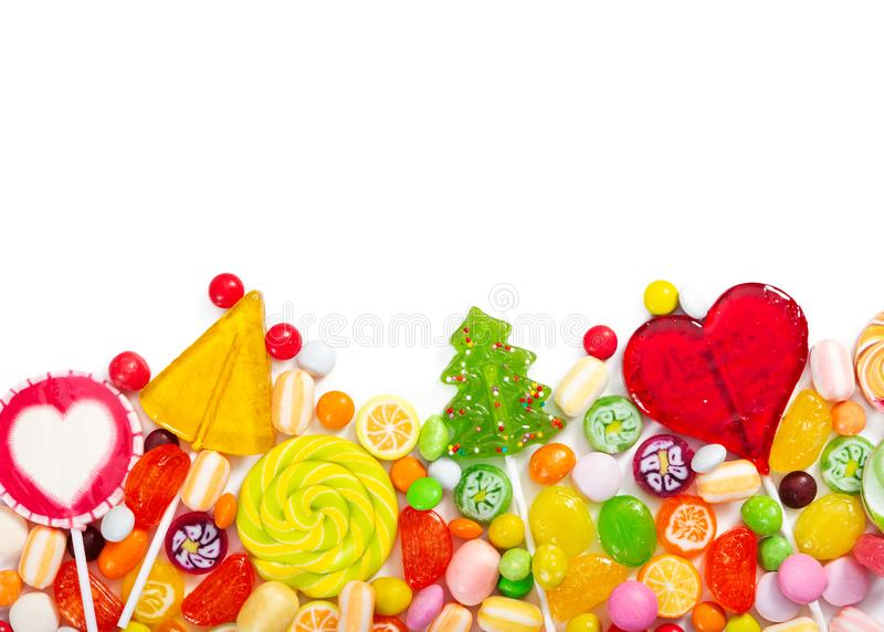 Colorful lollipops and different colorful candy isolated on white stock images