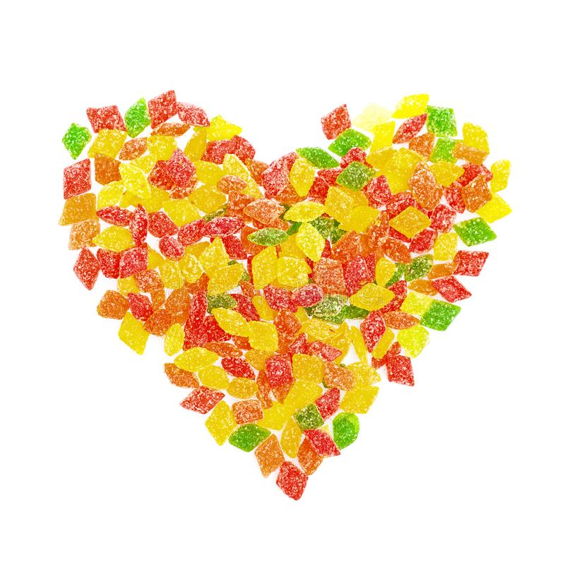 Colorful lollipops in shape heart and different colored candy. Top view. Sweets love concept royalty free stock photography