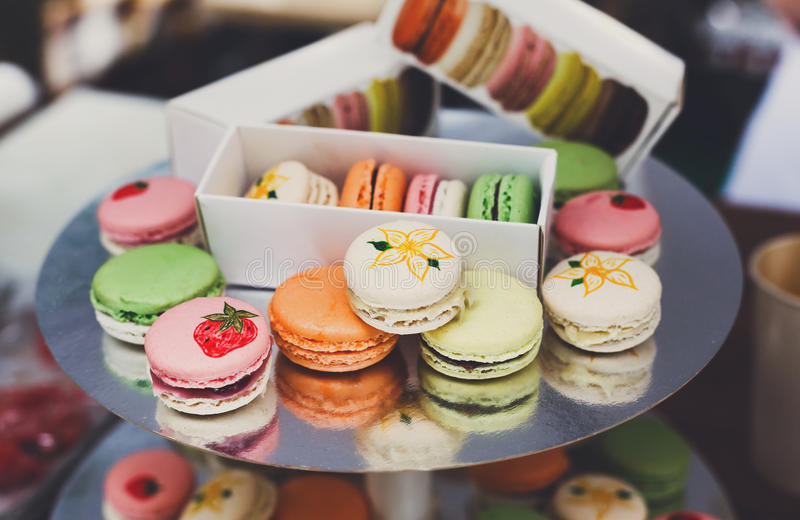 Colorful macaron cookies on bar for sale stock images
