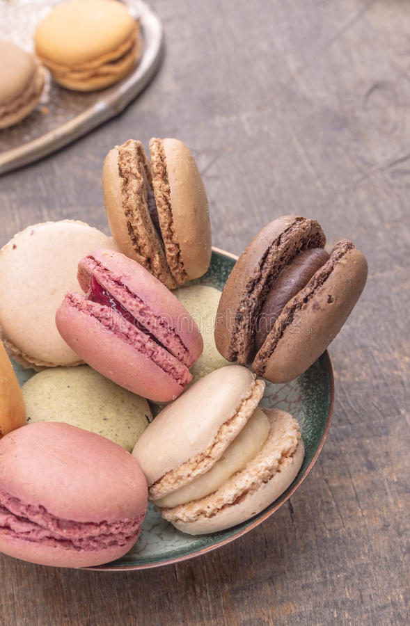 Colorful macarons in Blue vintage Bowl stock photos