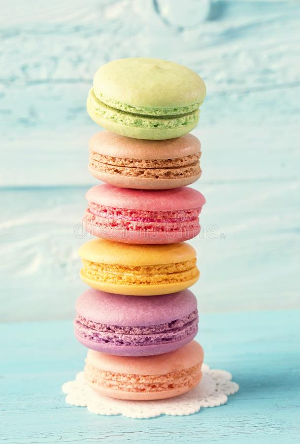 Colorful macarons. On a blue wooden background royalty free stock photos