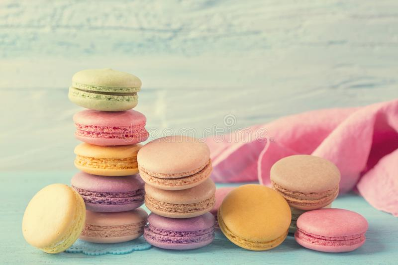Colorful macarons. On a blue wooden background royalty free stock photography