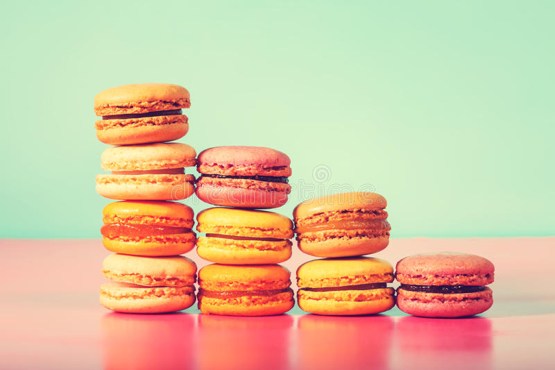 Colorful macarons on a bright pastel background stock image