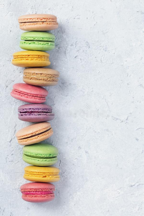 Colorful macarons. On a grey  background royalty free stock photography